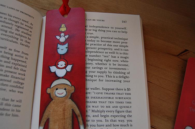 Sock monkey on book
